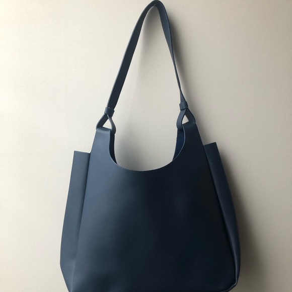 Neiman Marcus Handbags - Navy blue leather shoulder bag. Never used before